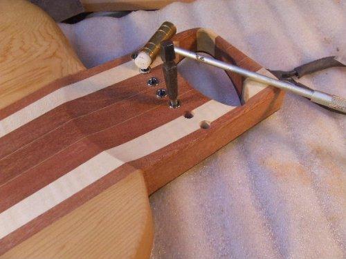 String Ferrules Through Guitar Body