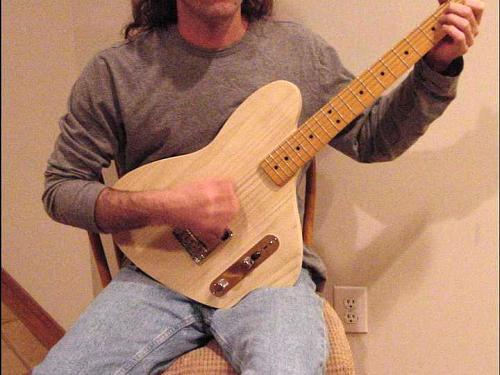 guitar position on left leg